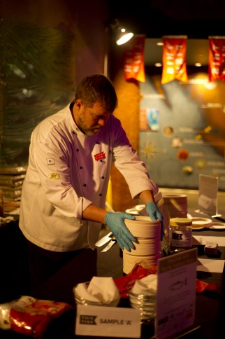 Chef hard at work preparing traceable food for reception attendees